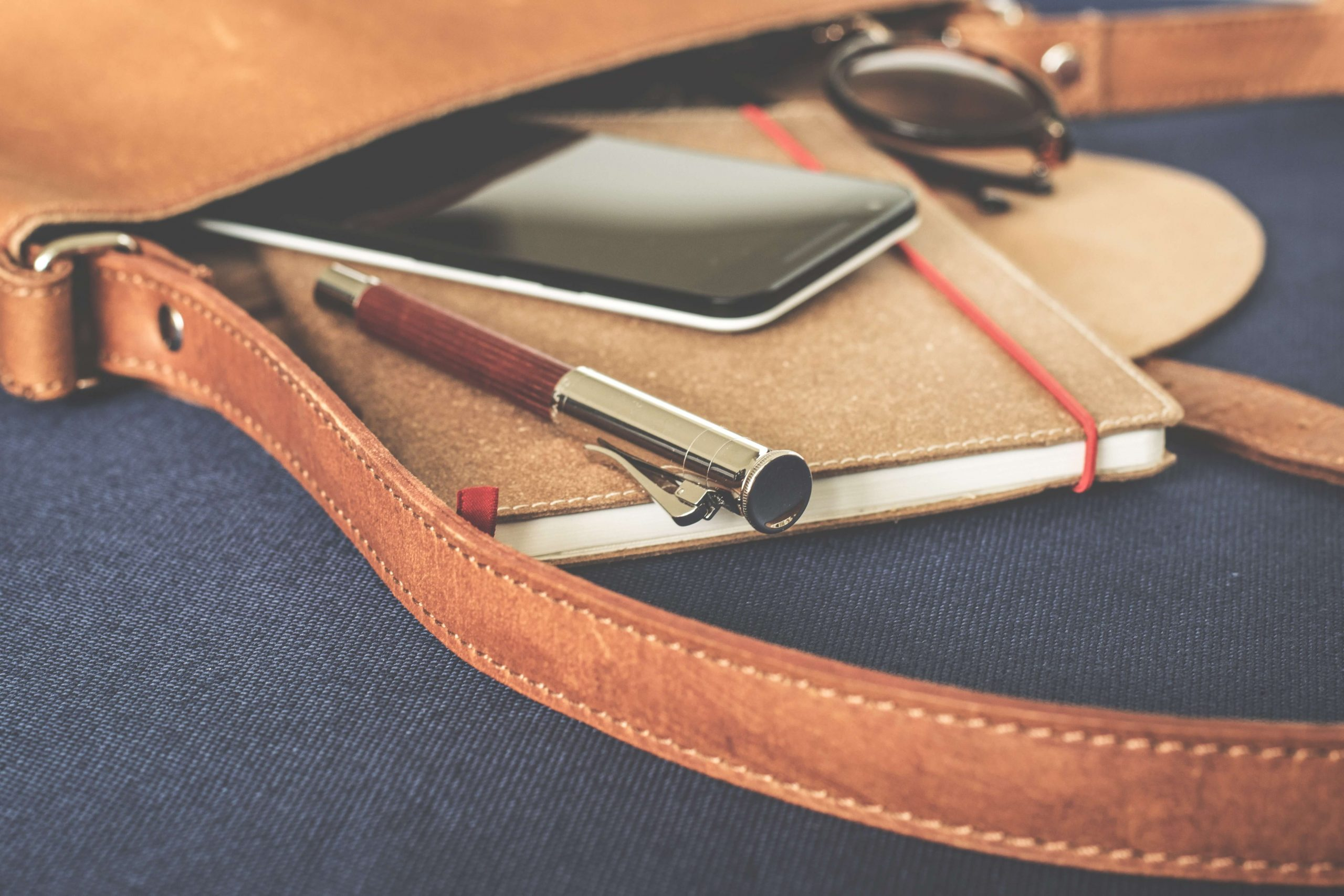 Fashion content marketing - satchel with notepad and pen