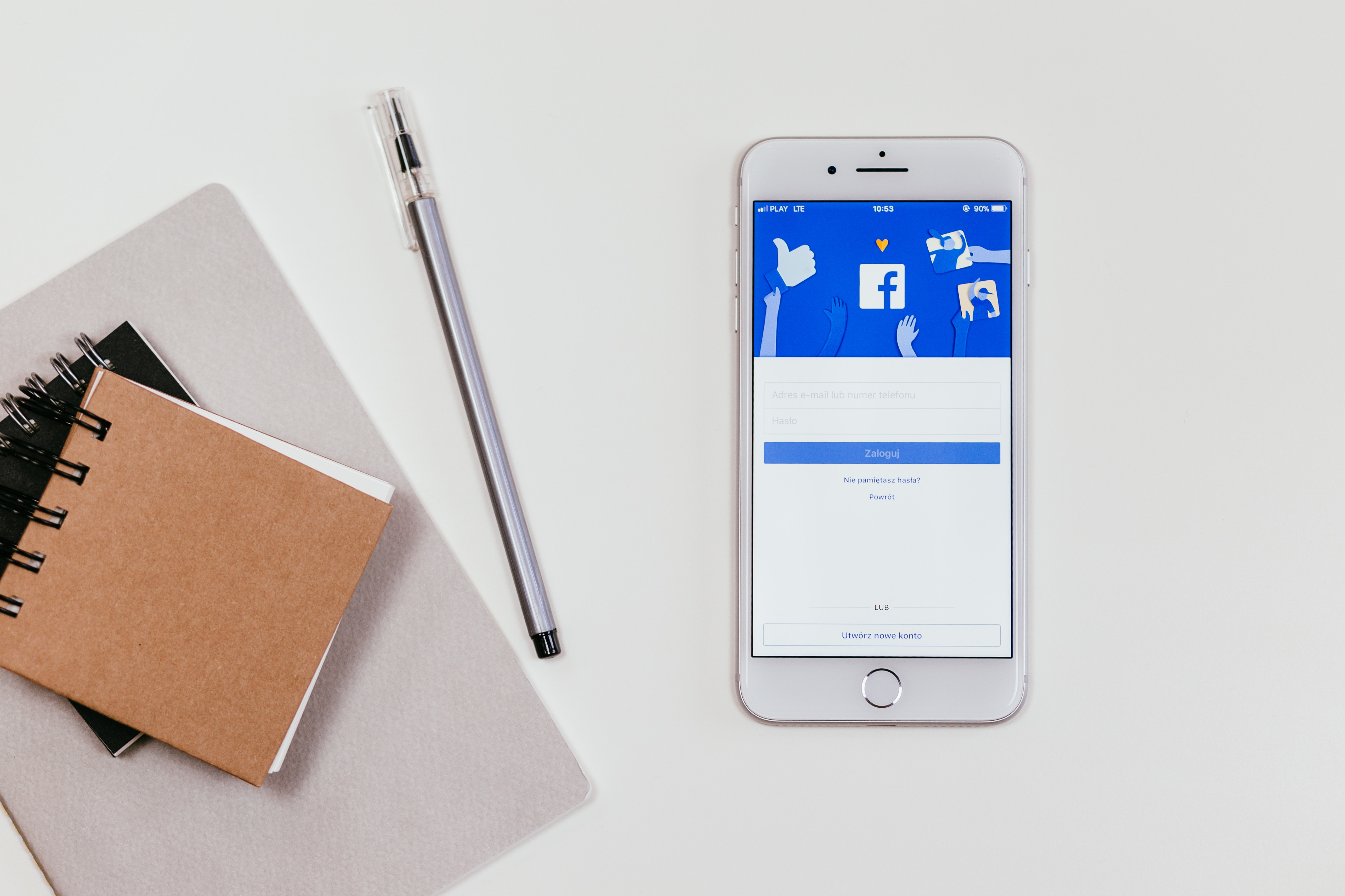 Facebook business page advice - notepad and Facebook on mobile